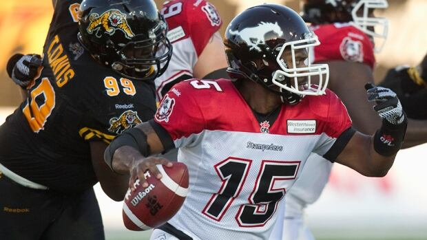 Calgary Stampeders quarterback Kevin Glenn (15) scrambles with the football in the first half against the  Hamilton Tiger-Cats on Saturday.