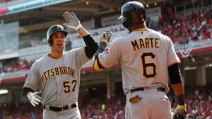 Andrew Lambo celebrates with Starling Marte of the Pittsburgh Pirates after hitting a solo home run against the Cincinnati Reds on September 28, 2013 in Cincinnati, Ohio.