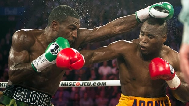 Adonis Stevenson, right, trades punches with Tavoris Cloud in their title fight Saturday, September 28, 2013 in Montreal.