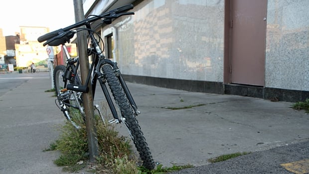 This bike was locked to a No Parking sign in downtown Hamilton.