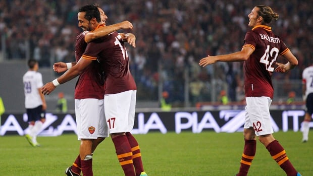 AS Roma player celebrate a goal against Bologna at Rome's Olympic stadium, Sunday, Sept. 29, 2013.