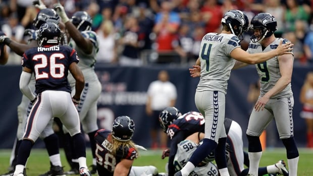 Seattle Seahawks' Jon Ryan, right, celebrates with kicker Steven Hauschka after the winning field goal against the Houston Texans on Sunday, Sept. 29, 2013, in Houston. The Seahawks defeated the Denver Broncos in yesterday's Super Bowl.