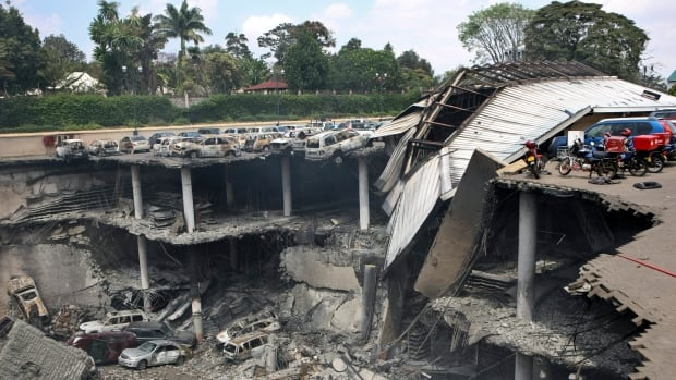 This photo provided by the Kenya Presidency shows the collapsed upper parking deck atop the Westgate Mall in Nairobi, Kenya. (AP Photo/Kenya Presidency)