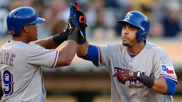 Rangers outfielder Nelson Cruz, right, returns from a 50-game drug suspension to play in Monday's AL wild-card tiebreaker against Tampa Bay.  He is 9-for-21 with three homers in his career against Rays scheduled starter David Price.