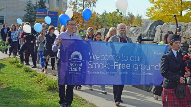 Smoke-free advocates march on the grounds of Thunder Bay Regional Health Sciences Centre to help raise awareness that smoking will not be permitted.