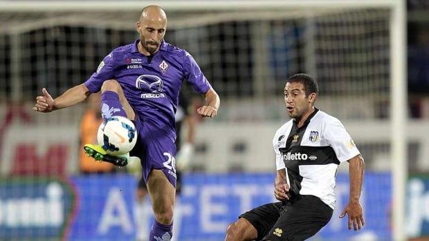 Borja Valero, left, of Fiorentina fights for the ball with Walter Gargano of Parma at Stadio Artemio Franchi on Monday in Florence, Italy.