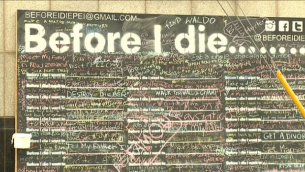 A chalkboard installed on The Guild in Charlottetown invites passers-by to share things they would like to do before they die.