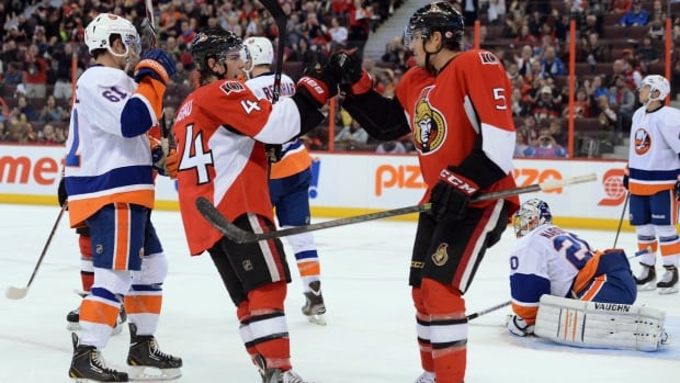 Cody Ceci, right, celebrates with Jean-Gabriel Pageau, after scoring the Senators' only goal in a 4-1 pre-season loss to the New York Islanders.