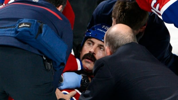 Montreal Canadiens forward George Parros is treated by medical staff after hitting his head on the ice during a fight with Toronto Maple Leafs forward Colton Orr during the third period Tuesday.