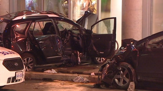 Two vehicles collided and smashed into the side of a Shoppers Drug Mart at the intersection of Bank Street and Laurier Avenue West early Wednesday morning.