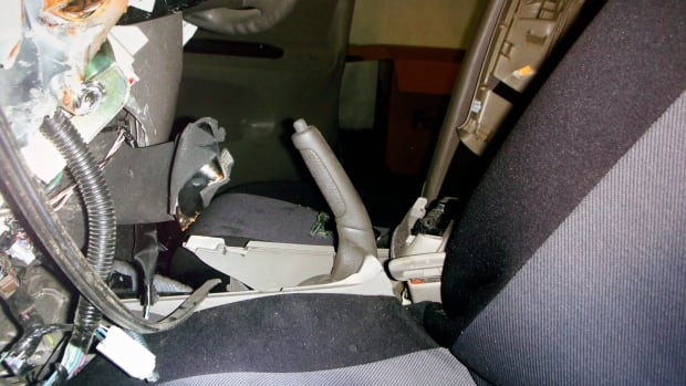 A photo of the interior of Noriko Uno's Toyota 2006 Camry is shown with the hand brake handle pulled all the way back. Her family claims her vehicle accelerated suddenly despite her efforts.