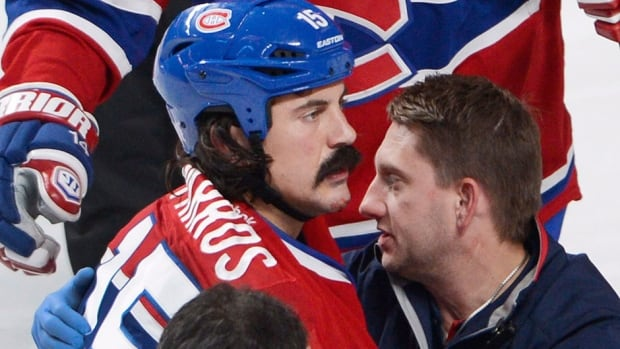 Canadiens tough guy George Parros, seen here being treated by team medical staff Tuesday night, suffered a concussion after hitting his head on the ice during a fight with the Maple Leafs' Colton Orr. Parros was released from hospital on Wednesday.