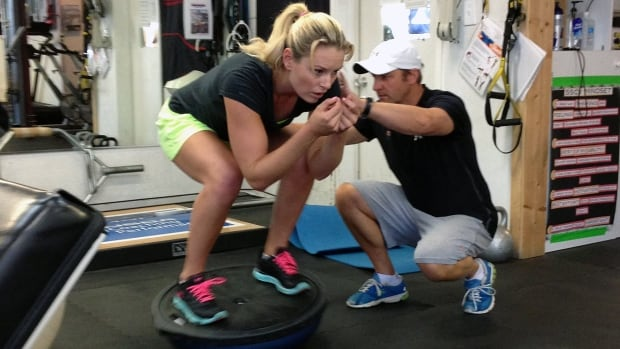 U.S skier Lindsey Vonn, seen working out in August with Red Bull coach Martin Hager in Vail, Colo., saw her 2012-13 season end in early February due to torn right knee ligaments.