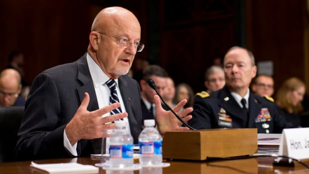 National Intelligence Director James Clapper, left, accompanied by National Security Agency Director Gen. Keith Alexander, testifies on Capitol Hill in Washington, on Wednesday.
