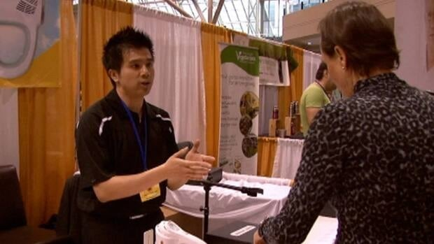 Genesis Light Health vice-president Timothy Fung speaks to a customer at the Total Health Show in Toronto.