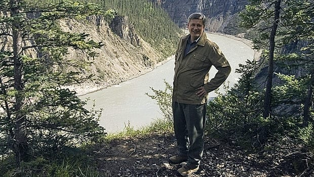 Prime Minister Stephen Harper stands by the Nahanni River in Nahanni National Park Reserve, Northwest Territories, during a trip in 2007. Harper is set to announce a new reserve or park along the river during his latest visit.