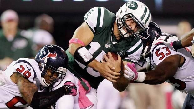 Tim Tebow, centre, has played a limited role in his first season with the Jets.