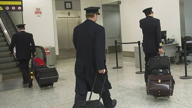 Air Canada pilots head to work at Pearson International Airport in Toronto earlier this month. Relations between the air carrier and its pilots have become increasingly acrimonious even as government legislation forestalled a strike or lockout.