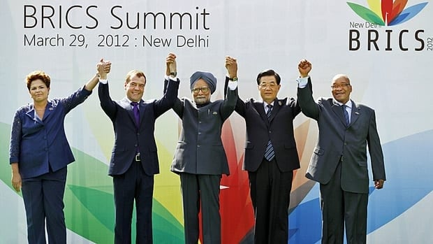 From left to right, Brazil's President Dilma Rousseff, Russian President Dmitry Medvedev, Indian Prime Minister Manmohan Singh, Chinese President Hu Jintao and South African President Jacob Zuma pose at the BRICS 2012 Summit in New Delhi on March 29.