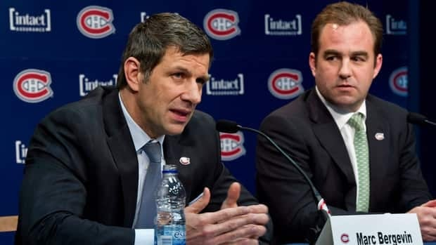 Marc Bergevin, left, responds to a question after being introduced as the Montreal Canadiens new general manager as president and CEO Geoff Molson, right, looks on.