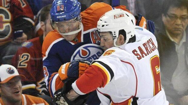 """Flames GM Jay Feaster said he wanted Cory Sarich back because the club liked his physical presence on the blue-line. """"Cory is a true competitor who plays the game the right way, with fire and grit."""""""