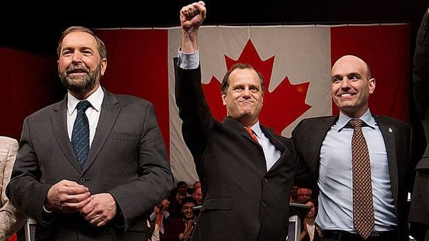 NDP leadership candidates Thomas Mulcair, from left, Brian Topp, and Nathan Cullen pose for a photograph prior a debate in Vancouver, B.C., on March 11, 2012. The debate is the last before the party elects a new leader to replace the late Jack Layton at a convention March 23 and 24 in Toronto.