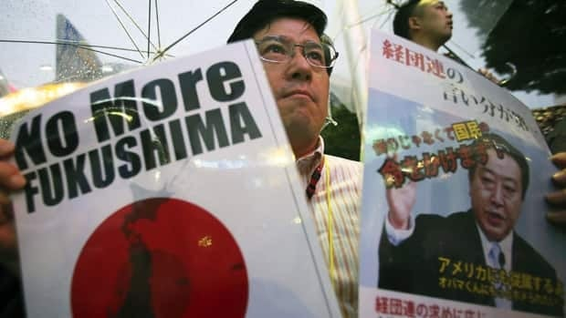 A protester holding a sign featuring a likeness of Japanese Prime Minister Yoshihiko Noda takes part in a rally against the restart of Ohi nuclear power plant, in Tokyo on July 1, 2012.