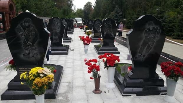 A look at the monument for fallen members of the KHL's Lokomotiv Yaroslavl hockey club in Leontyevskoe cemetery on the one year anniversary of the tragedy.