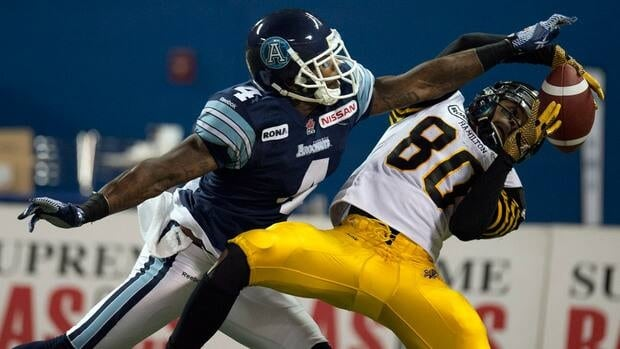 Hamilton Tiger-Cats wide receiver Chris Williams hauls in a touchdown pass against Toronto Argonauts defensive back Pacino Horne on Thursday.