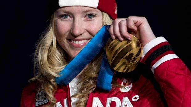 In this photo, ski-cross gold medallist Canadian Ashleigh McIvor poses with her Olympic gold medal during the medals ceremony in Vancouver, BC on Tuesday, Feb. 23, 2010.