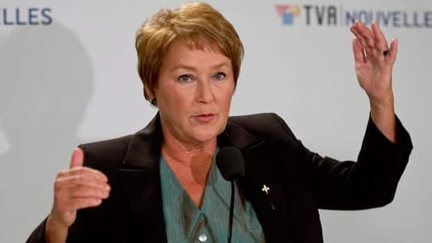 PQ Leader Pauline Marois responds to questions following her one-on-one debate Monday with Liberal Leader Jean Charest in Montreal, possibly one of her last confrontations with her old rival.