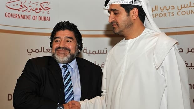 Argentinian football legend Diego Maradona, left, shakes hands with Ahmed al-Sharif, secretary general of Dubai Sports Council, during a press conference on September 2 to announce that Maradona has been appointed as Honorary Ambassador of Sports in Dubai.