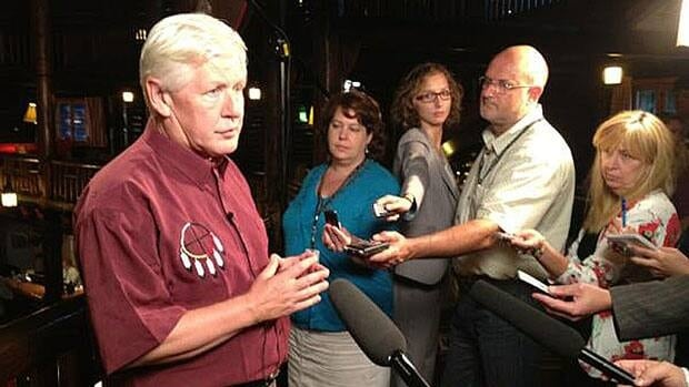 Interim Liberal Leader Bob Rae talks to reporters at his party's summer caucus retreat in Montebello, Que. Tuesday.