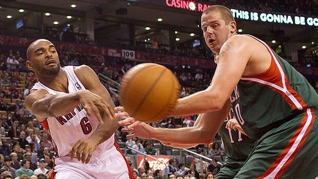 Toronto's Alan Anderson, left, plays a pass beyond Joel Przybilla of Milwaukee during second half NBA pre-season action on Monday.