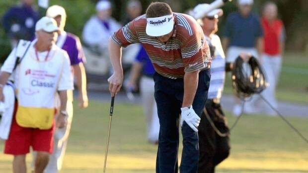 Charlie Beljan bends over due to an illness on the 18th hole during the second round of the Children's Miracle Network Hospitals Classic in Lake Buena Vista, Fla., Friday, Nov. 9, 2012.