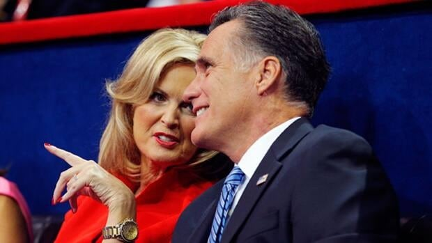 Republican presidential nominee Mitt Romney and his wife Ann listen as New Jersey Gov. Chris Christie delivers the keynote address at the party's convention in Tampa, Fla., on Tuesday night.