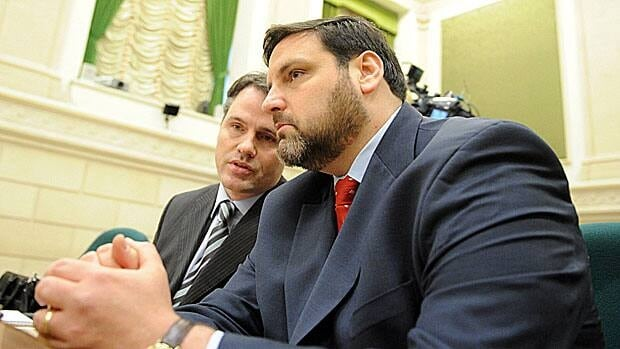 Adam Carroll, the former Liberal staffer who set up the vikileaks Twitter account to publicize details from the divorce filings of Public Safety Minister Vic Toews, speaks to his lawyer Paul Champ before a committee meeting. Carroll says the divorce documents were available in a filing cabinet in the Liberal Research Bureau.