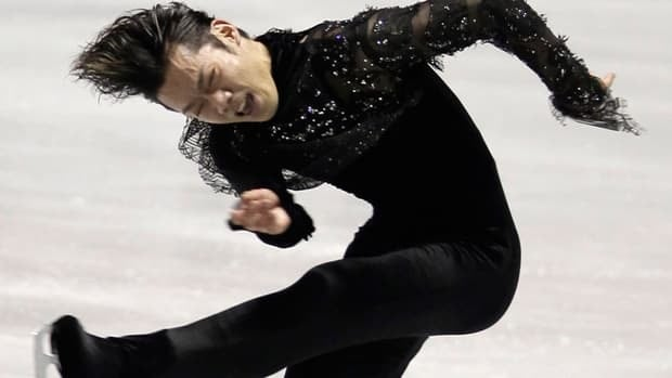 World silver medallist Daisuke Takahashi took a massive lead over Canadian and world champion Patrick Chan at the World Team Trophy event on Thursday in Tokyo.
