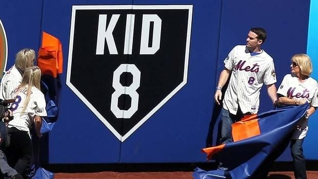 The family of former New York Mets and Montreal Expos catcher Gary Carter, including his wife Sandy, son D.J. and daughters Kimmy and Christy, unveil a sign on the outfield wall in honour of the late Hall of Famer prior to Thursday's season opener.