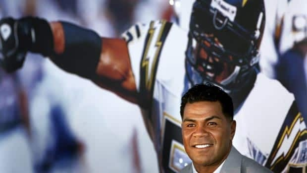 Junior Seau, seen announcing his retirement in 2006, played for 20 seasons in the NFL.