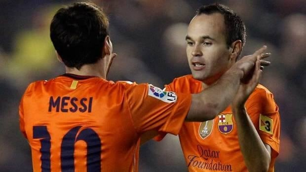 Barcelona's Lionel Messi is congratulated by teammate Andres Iniesta, right, after scoring a goal against Levante during their match at the Ciutat Valencia stadium in Valencia, Spain on Sunday.