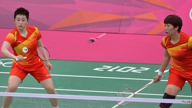 Yu Yang, left, blogged on Wednesday that she is quitting badminton after she, her Chinese teammate Wang Xiaoli, right, and six others were kicked out of the London Olympics for trying to lose.