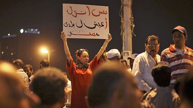 An Egyptian woman holds a banner saying I want my country for my people at a demonstration against presidential candidate Ahmed Shafik in Cairo May 28. The runoff vote for Egypt's next president will pit the Muslim Brotherhood's candidate against the last prime minister to serve under Hosni Mubarak. Protests erupted during the weekend over Mubarak's acquittal on charges of corruption.