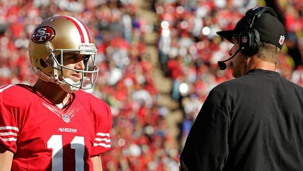 Quarterback Alex Smith and head coach Jim Harbaugh of the San Francisco 49ers talk during a break in play against St. Louis Rams in the first quarter on November 11, 2012 at Candlestick Park in San Francisco, California. Smith left the game in the second quarter and the teams tied 24-24 in overtime.