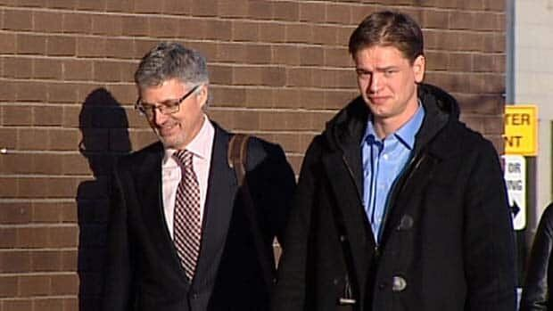 Justin Frank (right) enters the Leduc Provincial Court building with lawyer Rick Muenz, Wednesday.