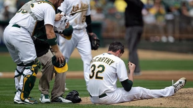 Oakland Athletics catcher Derek Norris, left, comes to the aid of Brandon McCarthy who was hit in the head by a ball hit by Los Angeles Angels' Erick Aybar on Wednesday.