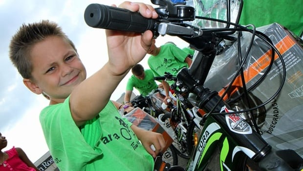 Brandon Patterson, 8, is all smiles after getting his free mountain bike thanks to the Earn-a-bike program.