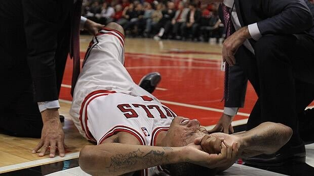 Derrick Rose of the Chicago Bulls is examined after suffering an injury against the Philadelphia 76ers during the 2012 NBA Playoffs.