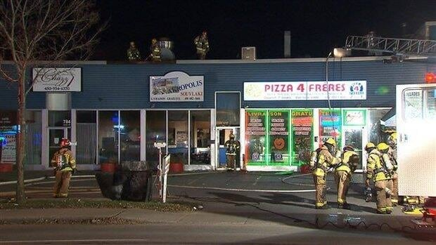 Firefighters alerted police after detecting a gas odor at a suspcicious fire in Laval on Wednesday morning.