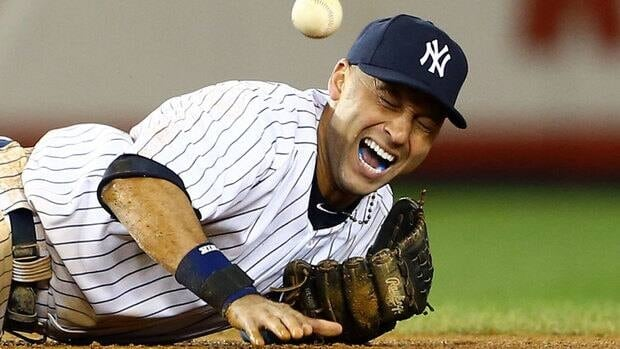 Yankees shortstop Derek Jeter grimaces in pain after injuring his left ankle while trying to field a ball in the 12th inning.